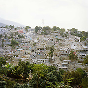 The City from the Hill leading into Petion-Ville. On Tuesday 12th of January at 16.53pm local time the biggest Earthquake to hit Haiti for 200 years struck with devastating force. 230,000 people were killed, 300,000 injured and 1.2 million left needing emergency shelter. Survivors have lost family, homes, livelihoods and essential services. Hospitals, schools and government buildings were also destroyed'. These pictures are of the survivors three weeks later.