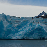 Ice towers called seracs teeter at the calving front of Grey Glacier, where Chile's huge southern icecap flows into Grey Lake in Torres del Paine National Park.