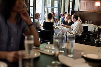 """24 July, 2008. New York, NY. Customers have lunch at the Hundred Acres restaurant and bar in the Village. Vicki Freeman and her husband Marc Meyer, co-owners of the Hundred Acres, opened the restaurant on May 22nd, 2008. """"I wanted to open a great neighborhood restaurant. The Hundred Acres is a sustainable restaurant and 90% of the products we use are organic"""" says co-owner Vicki Freeman.<br /> ©2008 Gianni Cipriano for The New York Times<br /> cell. +1 646 465 2168 (USA)<br /> cell. +1 328 567 7923 (Italy)<br /> gianni@giannicipriano.com<br /> www.giannicipriano.com"""