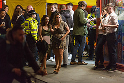 © Licensed to London News Pictures. 28/05/2021. London, UK. Revellers make the most of Friday night out in Soho, central London ahead of bank holiday.  Photo credit: Marcin Nowak/LNP
