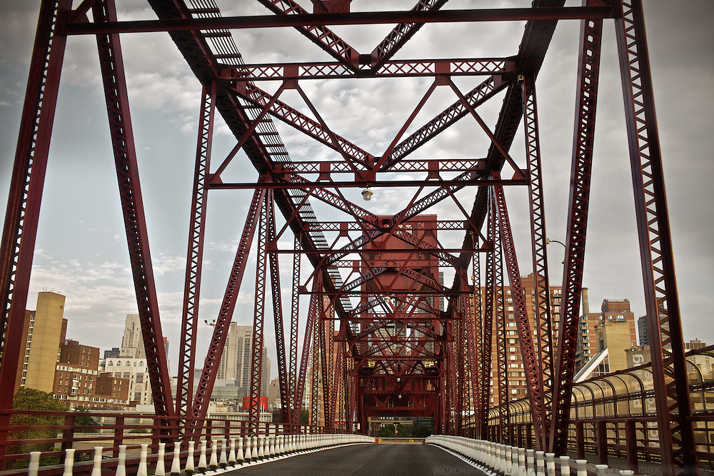 """Roosevelt island bridge, leaving Manhattan...A 4-weeks road trip across the USA, from New York to San Francisco, on the steps of Jack Kerouac's famous book """"On the Road"""".  Focusing on nomadic America: people that live on the move across the US, out of ideology or for work reasons."""