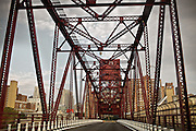 "Roosevelt island bridge, leaving Manhattan...A 4-weeks road trip across the USA, from New York to San Francisco, on the steps of Jack Kerouac's famous book ""On the Road"".  Focusing on nomadic America: people that live on the move across the US, out of ideology or for work reasons."