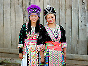 Portrait of White Hmong girls wearing contemporary Hmong traditional costume at Ban Hauywai Hmong New Year festival, Phongsaly province, Lao PDR. The Hmong celebration of New Year is based on the lunar calendar. This important time is an opportunity to honour ancestors and spirits through offerings and rituals and to partake in games, sports, feasts, shows, bullfights and courtship. The Hmong are the third largest ethnic group in Laos. One of the most ethnically diverse countries in Southeast Asia, Laos has 49 officially recognised ethnic groups although there are many more self-identified and sub groups. These groups are distinguished by their own customs, beliefs and rituals.