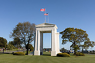 """The Peace Arch (1921) looking towards the United States.  Photographed from Peace Arch Provincial Park in Surrey, British Columbia, Canada.  The Peace Arch was built in 1921 to commemorate the 100 year anniversary of treaties at the end of the War of 1812 between the USA and Great Britain. One side states """"Children Of A Common Mother"""", the other """"Brethren Dwelling Together In Unity""""."""