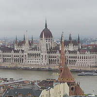 View of the city with the building of the Parliament in the centre on the other side of river Danube as seen from the Castle hill on the Buda side of the city on a rainy spring day in Budapest, Hungary on May 15, 2019. ATTILA VOLGYI