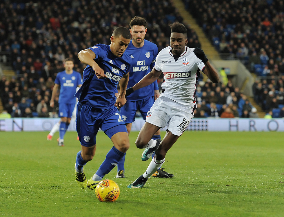 Cardiff City's Lee Peltier under pressure from Bolton Wanderers' Sammy Ameobi<br /> <br /> Photographer Kevin Barnes/CameraSport<br /> <br /> The EFL Sky Bet Championship - Cardiff City v Bolton Wanderers - Tuesday 13th February 2018 - Cardiff City Stadium - Cardiff<br /> <br /> World Copyright © 2018 CameraSport. All rights reserved. 43 Linden Ave. Countesthorpe. Leicester. England. LE8 5PG - Tel: +44 (0) 116 277 4147 - admin@camerasport.com - www.camerasport.com