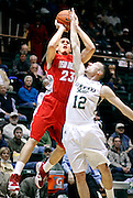 SHOT 2/23/10 9:07:29 PM - Colorado State's Adam Nigon tries to block a shot by New Mexico's Phillip McDonald during the first half of their regular season Mountain West Conference game at Moby Arena in Fort Collins, Co. New Mexico survived a tight game winning 72-66. (Photo by Marc Piscotty / © 2010)