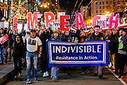 """SAN FRANCISCO, CA - DECEMBER 17: Several hundred protesters march down Market Street during demonstrations in part of a national impeachment rally in San Francisco, California on December 17, 2019. Protesters around the nation participated in """"Nobody is Above the Law"""" rallies on the eve of a historic Trump impeachment vote in the United States House of Representatives. (Photo by Philip Pacheco/AFP)"""