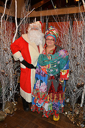 Father Christmas and CAMILLA BATMANGHELIDJH at a party hosted by Camila Batmanghelidjh for Kids Company held at The Ivy Market Grill, 1 Henrietta Street, Covent Garden, London on 23rd November 2014.