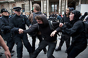 London, UK. Tuesday 11th June 2013. Police scuffle with and arrest an anti capitalist protester during a demonstration against the upcoming G8 summit in central London, UK.