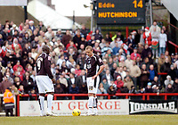 Photo: Leigh Quinnell.<br /> Brentford v Swansea City. Coca Cola League 1.<br /> 26/12/2005. Swanseas Lee Trundle and  Adebayo Akinfenwa kick off after Brentfords second goal.