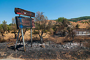 A sign of Roccabernarda village of the National park of Sila is burnt due to the fires that hits the area on August 03, 2017 in Crotone, Italy. An intense heatwave is sweeping across many regions of Italy, prompting local councils to issue a number of high level alerts. The province of Crotone has suffered much damage due to the fires over the last few weeks. ©Simone Padovani