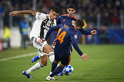 November 27, 2018 - Turin, Italy - Joao Cancelo of Juventus (L) disputes the ball with Gonzalo Guedes (R) and Jose Luis Gaya (C) of Valencia during the UEFA Champions League match between Juventus and Valencia CF at Allianz Juventus Stadium  in Turin, Italy on November 27, 2018  (Credit Image: © Jose Breton/NurPhoto via ZUMA Press)