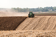 Tractor plowing a field, countryside, Israel