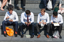 © Licensed to London News Pictures. 14/09/2016. London, UK. People on their lunch break enjoy the hot weather around City Hall as September's mini heatwave continues.  Photo credit : Stephen Chung/LNP