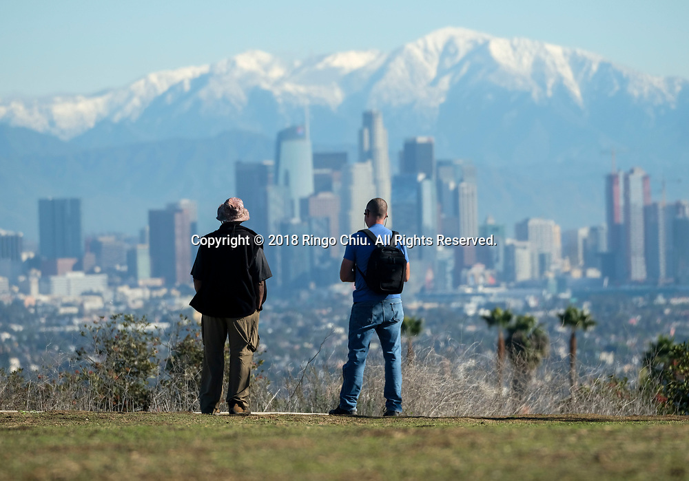 Snow covered the San Gabriel Mountains behind the Downtown Los Angeles skyline is seen at Kenneth Hahn State Recreation Area on Friday December 7, 2018 in Los Angeles.(Photo by Ringo Chiu)<br /> <br /> Usage Notes: This content is intended for editorial use only. For other uses, additional clearances may be required.