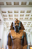 A large ancient Egyptian statue of Amenhotep III, c. 1370 BC in room 4 of British Museum, London, England