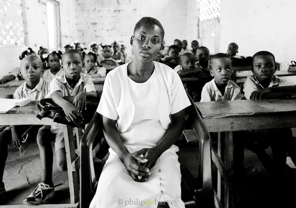 A school teacher with her class in Cap-Haïtien, Haiti