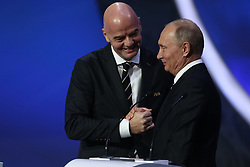 December 1, 2017 - Moscow, Russia - FIFA President, Gianni Infantino (L) and Vladimir Putin President of Russia (R) speaks to the crowd during the Final Draw for the 2018 FIFA World Cup Russia at the State Kremlin Palace on December 1, 2017 in Moscow, Russia  (Credit Image: © Igor Russak/NurPhoto via ZUMA Press)