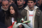 An VETEVENDOSJE! Activist hold flowers in the hand to put them on the memory flagstone of two Martyrs Arben XHELADINI and Mon BALAJ
