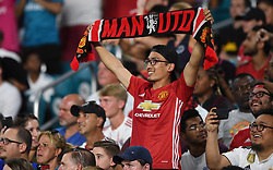 July 31, 2018 - Miami Gardens, FL, USA - Manchester United fans celebrate a goal against Real Madrid during International Champions Cup action at Hard Rock Stadium in Miami Gardens, Fla., on Tuesday, July 31, 2018. Manchester United won, 2-1. (Credit Image: © Jim Rassol/TNS via ZUMA Wire)