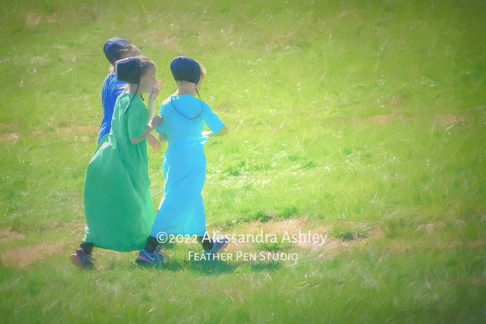 Three Amish schoolgirls in traditional clothing, outdoors at recess on a sunny day, one whispering a secret to the others. Watercolor effects blended with original photo.