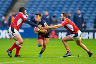 George Taylor (#12) of Edinburgh Rugby looks to break between Walter Desmaison (#3) and Johann Sadie (#13) of SU Agen Rugby during the European Rugby Challenge Cup match between Edinburgh Rugby and SU Agen at BT Murrayfield, Edinburgh, Scotland on 18 January 2020.