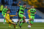 Forest Green Rovers Paul Digby(20) rides a challenge from Oxford United's Marcus Browne(10) during the The FA Cup 1st round match between Oxford United and Forest Green Rovers at the Kassam Stadium, Oxford, England on 10 November 2018.