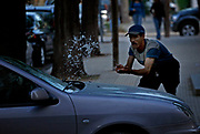 A man makes a few extra Dirahms by washing cars in the Ville Nouvelle of Fes, Morocco on Thursday evening, May 31, 2007. (PHOTO BY TIMOTHY  D. BURDICK)