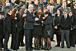 © Licensed to London News Pictures.  02/02/2012. CARTERTON, UK. Friends and family brave a bitterly cold day to pay their respects during the repatriation ceremony for Signaller Ian Sartorius-Jones, 200 Signals Squadron, who died on Tuesday 24 January 2012 at Forward Operating Base Khar Nikah in the Nahr-e Saraj district of Helmand province, Afghanistan. Photo credit :  Cliff Hide/LNP