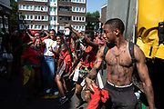 Happy revellers at Notting Hill Carnival on 25th August 2019 in West London, United Kingdom. A celebration of West Indian / Caribbean culture and Europes largest street party, festival and parade. Revellers come in their hundreds of thousands to have fun, dance, drink and let go in the brilliant atmosphere. It is led by members of the West Indian / Caribbean community, particularly the Trinidadian and Tobagonian British population, many of whom have lived in the area since the 1950s. The carnival has attracted up to 2 million people in the past and centres around a parade of floats, dancers and sound systems.