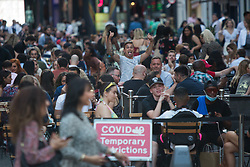 © Licensed to London News Pictures.  16/07/2021. London, UK. Members of the public make the most of Friday night out in Soho, central London ahead of easing Lockdown restriction on 19 July. Photo credit: Marcin Nowak/LNP