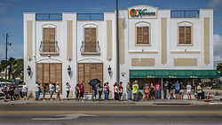 September 11, 2017 - West Palm Beach, Florida, U.S. - Dozens wait in line for food and beverages at Havana restaurant in West Palm Beach. Cleanup will continue for several days following the tropical storm force winds and several tornadoes spawned by Hurricane Irma in central Palm Beach County. (Credit Image: © Thomas Cordy/The Palm Beach Post via ZUMA Wire)