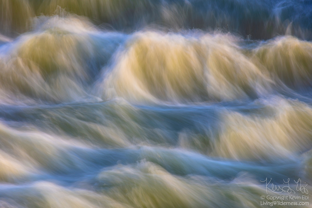The Potomac River forms a number of small cascades as flows over large rocks in Great Falls Park, Maryland.
