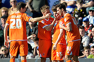 Blackpool players celebrate with  David Goodwillie's (2nd right) after he scores his sides 1st goal of the game . Skybet football league championship match , Queens Park Rangers v Blackpool at Loftus Road in London  on Saturday 29th March 2014.<br /> pic by John Fletcher, Andrew Orchard sports photography.