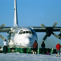 ANTARCTICA, Queen Maud Land.  Polar Logistics C-130 Hercules plane taxis on bare ice glacier at Blue One expedition base.