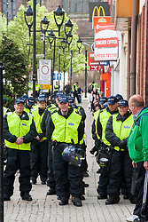 Police Officers policing the end of the  EDL Rally in Rotherham Town Centre South Yorkshire on Saturday<br /> <br /> May 10 2014<br /> Image © Paul David Drabble <br /> www.pauldaviddrabble.co.uk