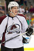 DALLAS, TX - SEPTEMBER 26:  Nathan MacKinnon #29 of the Colorado Avalanche looks on against the Dallas Stars in an NHL preseason game on September 26, 2013 at the American Airlines Center in Dallas, Texas.  (Photo by Cooper Neill/Getty Images) *** Local Caption *** Nathan MacKinnon