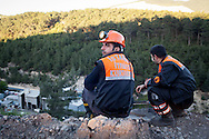 Rescue workers overlook the ongoing rescue effort at the coal mine during a break. Soma, western Turkey. An explosion caused by an electrical fault in Somas' coal mine resulted in at least 282 deaths. Rescue efforts continue into the third evening.
