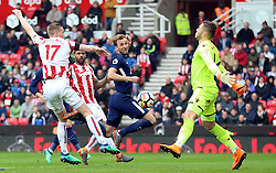 Tottenham Hotspur's Harry Kane scores his side's second goal of the game during the Premier League match at the bet365 Stadium, Stoke.