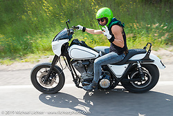 Jessi Combs on the Legends Ride from Deadwood, SD through Spearfish Canyon and to the Sturgis Buffalo Chip during the Sturgis Black Hills Motorcycle Rally. SD, USA. August 4, 2014.  Photography ©2014 Michael Lichter.