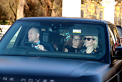 Mike and Zara Tindall, arrive for the Queen's Christmas lunch at Buckingham Palace, London.