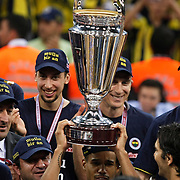 Fenerbahce's players Lynn Terence GREER (C) celebrate with the BEKO Basketball League Champions Cup trophy during their Turkish Basketball league Play Off Final Sixth Leg match Fenerbahce Ulker between Efes Pilsen at the Abdi Ipekci Arena in Istanbul Turkey on Wednesday 02 June 2010. Photo by Aykut AKICI/TURKPIX