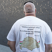 Man wearing a revisionist message to revive Hungary's borders before the Trianon treaty visit the newly inaugurated Memorial of Unity that is decorated with names of Hungarian towns (many of them belonging to neighbouring countries since the Treaty of Trianon) engraved onto the walls on the national holiday celebrating the foundation of the Hungarian State in Budapest, Hungary  on Aug. 20, 2020. ATTILA VOLGYI