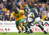 Photo: Daniel Hambury.<br />Norwich v Plymouth. Coca Cola Championship.<br />10/09/2005.<br />Norwich's on loan striker, Kevin Lisbie trys to get away from Plymouth's Taribo West (R) and Mathias Kouo-Doumbe.