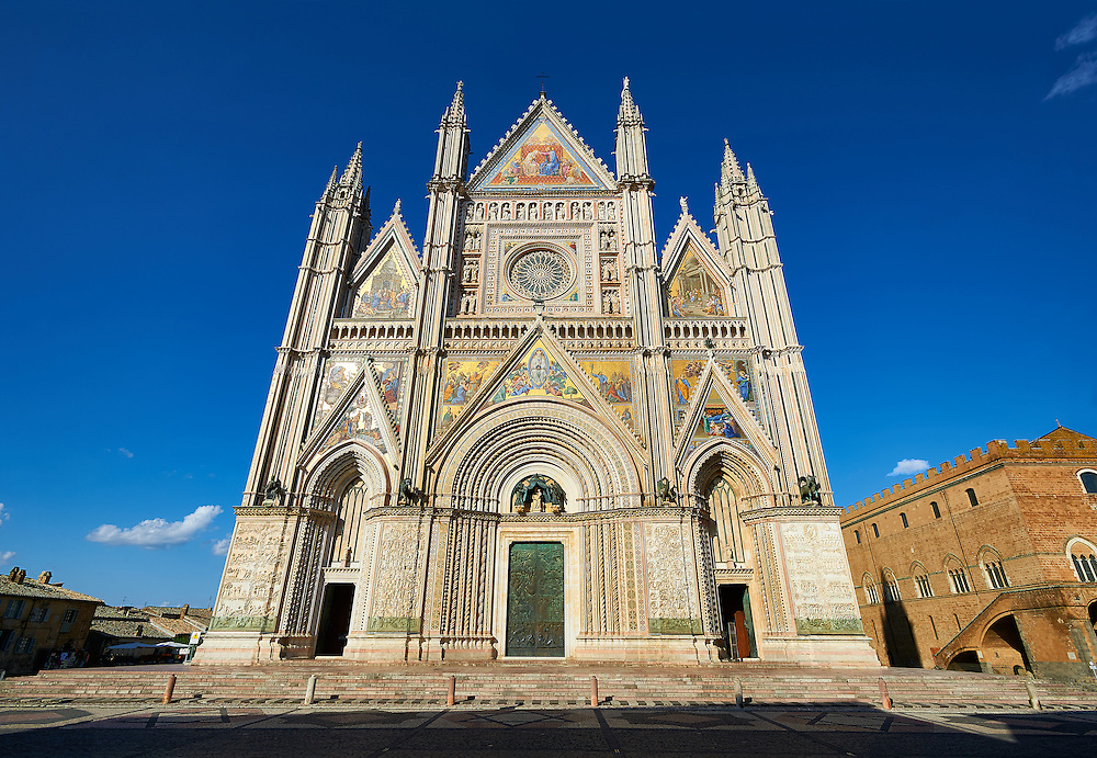 14th century Tuscan Gothic style facade of the Cathedral of Orvieto, designed by Maitani, Umbria, Italy .<br /> <br /> Visit our ITALY HISTORIC PLACES PHOTO COLLECTION for more   photos of Italy to download or buy as prints https://funkystock.photoshelter.com/gallery-collection/2b-Pictures-Images-of-Italy-Photos-of-Italian-Historic-Landmark-Sites/C0000qxA2zGFjd_k<br /> .<br /> <br /> Visit our MEDIEVAL PHOTO COLLECTIONS for more   photos  to download or buy as prints https://funkystock.photoshelter.com/gallery-collection/Medieval-Middle-Ages-Historic-Places-Arcaeological-Sites-Pictures-Images-of/C0000B5ZA54_WD0s