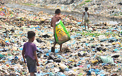 June 5, 2017 - Dimapur, Nagaland, India - Indian kids search for re-useable items on World Environment day at a Municipal waste dumping site in Dimapur, India north eastern state of Nagaland on Monday, June 05, 2017. World Environment Day is marked annually on June 5 with this year theme as 'Connecting People to Nature' (Credit Image: © Caisii Mao/NurPhoto via ZUMA Press)