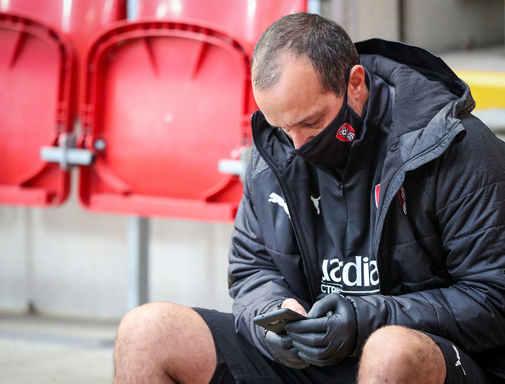 A member of Rotherham United's staff checks his phone during a break in play<br /> <br /> Photographer Alex Dodd/CameraSport<br /> <br /> The EFL Sky Bet Championship - Rotherham United v Huddersfield Town - Saturday 3rd October 2020 - New York Stadium - Rotherham<br /> <br /> World Copyright © 2020 CameraSport. All rights reserved. 43 Linden Ave. Countesthorpe. Leicester. England. LE8 5PG - Tel: +44 (0) 116 277 4147 - admin@camerasport.com - www.camerasport.com