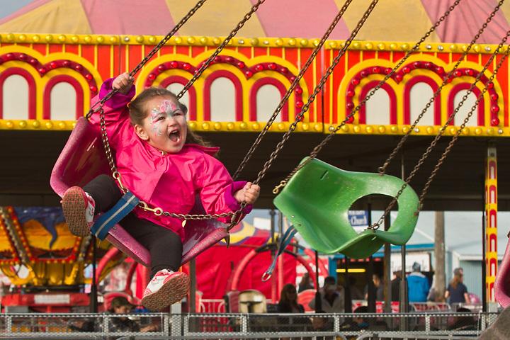 Three year old, Ellianna, on the Swing at the Alaska State Fair, Palmer, Alaska