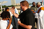 Pastor Matt O'Donnell blesses participants attending a sunrise mass at Rainbow Beach on the Chicago's south side. August 25, 2012 l Brian J. Morowczynski~ViaPhotos...For use in a single edition of Catholic New World Publications, Archdiocese of Chicago. Further use and/or distribution may be negotiated separately. Contact ViaPhotos at 708-602-0449 or email brian@viaphotos.com.
